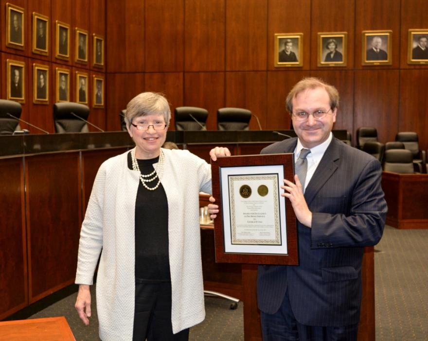 Judge Joan B. Gottschall and George D. Sax